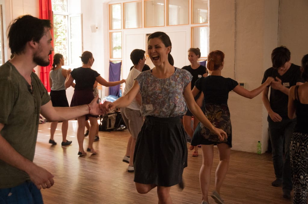Lindy Hop dancers learning in class