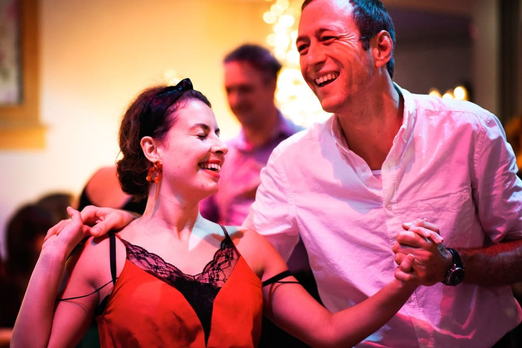 two lindy hop dancers having fun at a swingstep heidelberg party