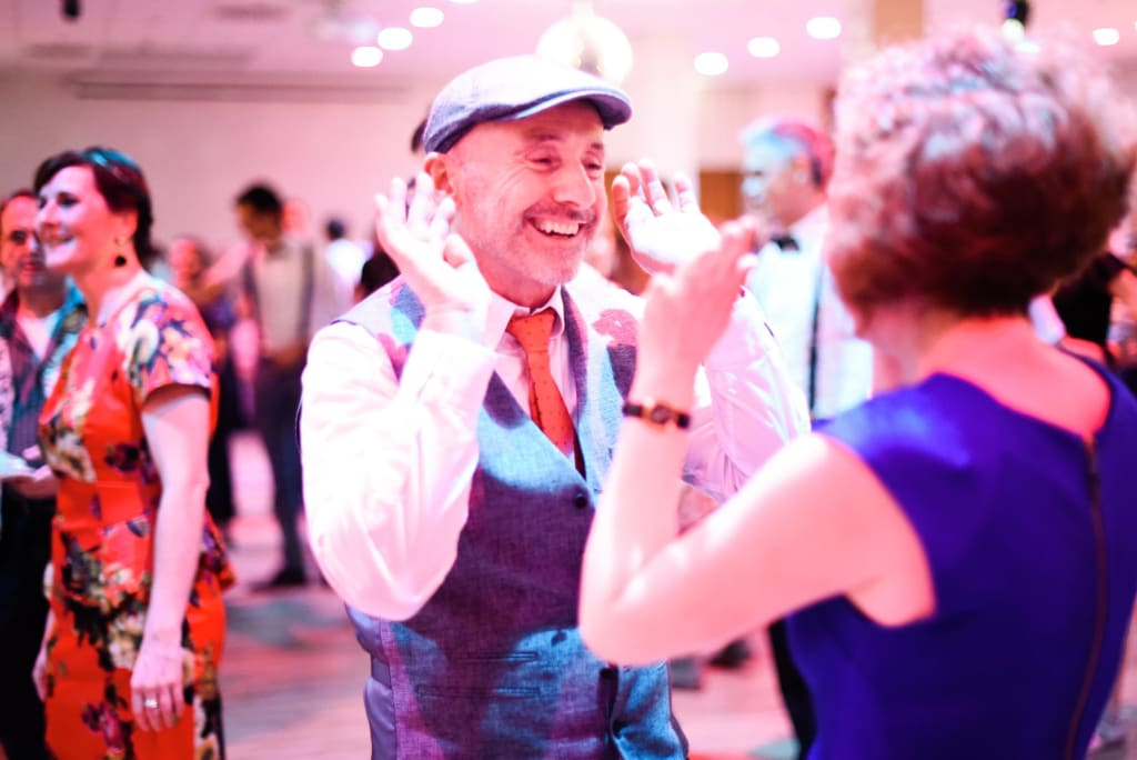 swing dance students smiling in lindy hop class at winterball Heidelberg